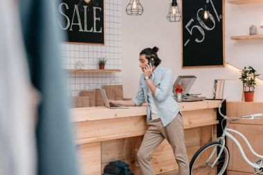 boutique owner using devices