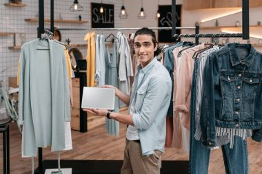 man with digital tablet in boutique
