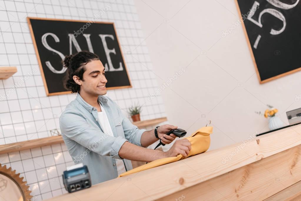 seller scanning clothing