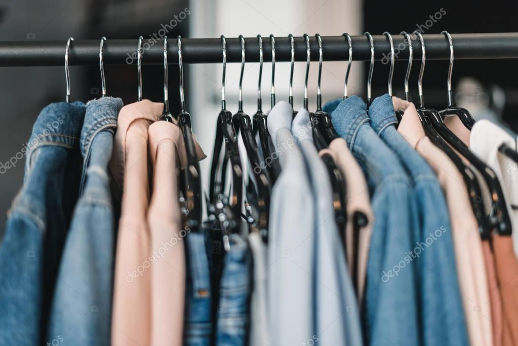 Stylish clothes on hangers