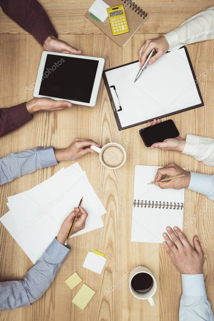 businesspeople on meeting at workplace