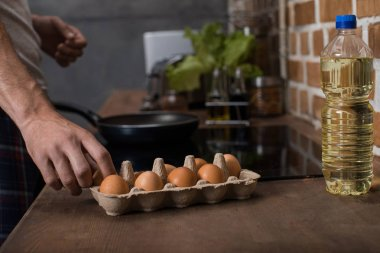 man preparing food for breakfast
