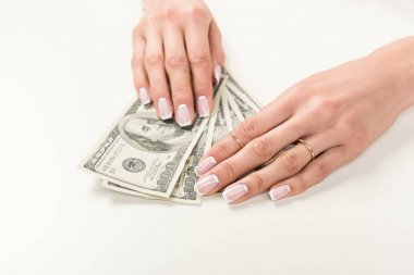 Female hands with dollar banknotes