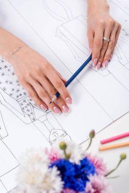 fashion designer working with sketches