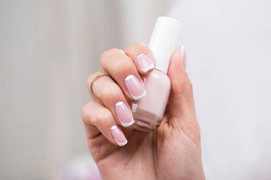 woman holding nail polish