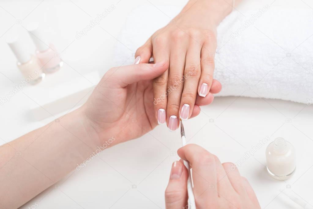 Manicurist doing manicure