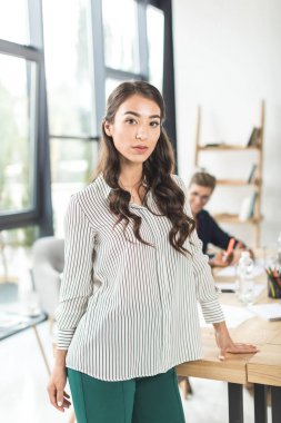 Asian businesswoman at workplace in office