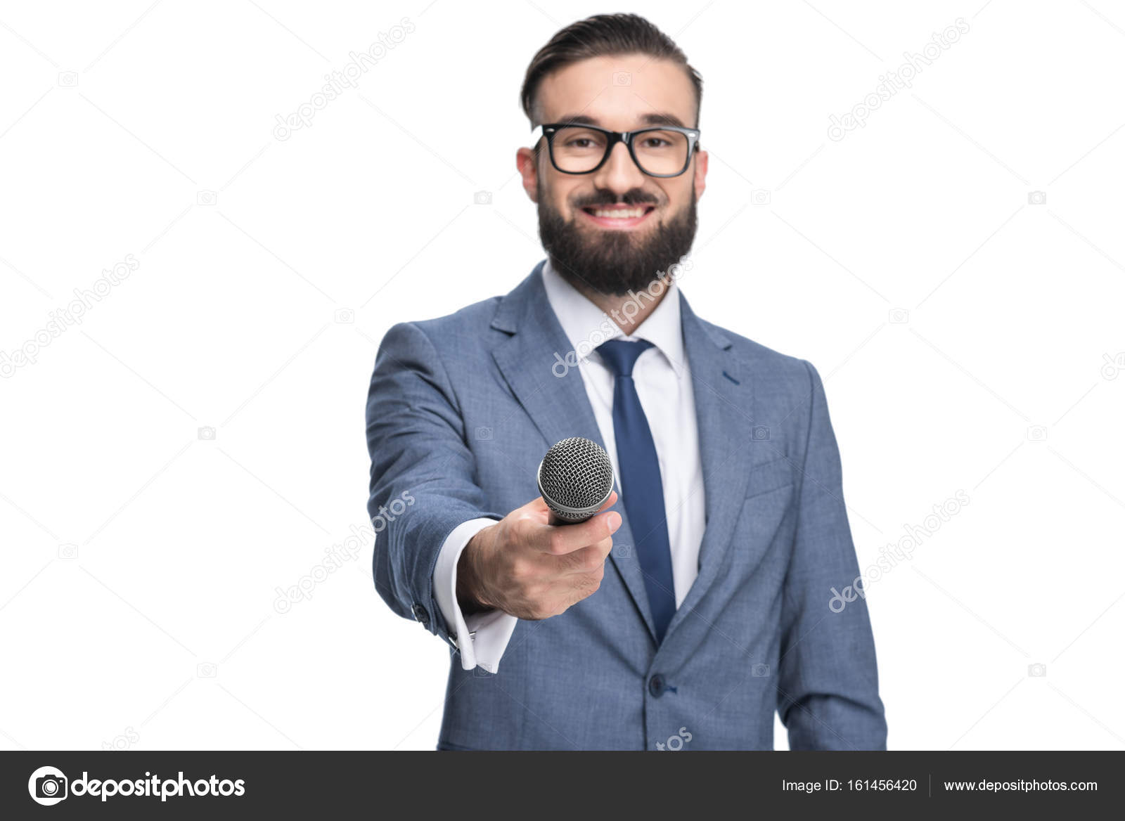 journalist taking interview with microphone stock photo