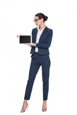 Beautiful businesswoman presenting digital tablet with blank screen, isolated on white stock vector