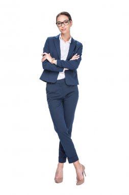 Attractive smiling businesswoman with crossed arms posing in suit and eyeglasses, isolated on white stock vector