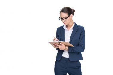 businesswoman writing in diary