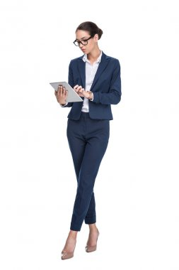 Serious beautiful businesswoman using digital tablet, isolated on white stock vector