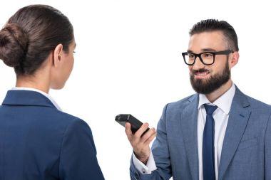 journalist taking interview with businesswoman
