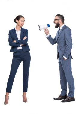 businessman with megaphone screaming on coworker
