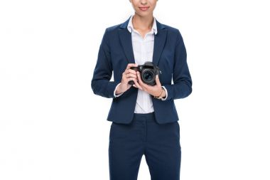 businessman holding professional camera