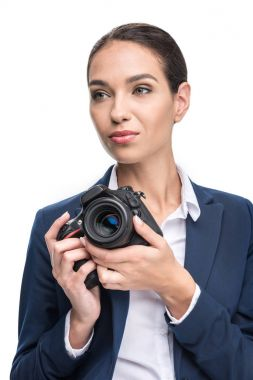 businesswoman holding professional camera