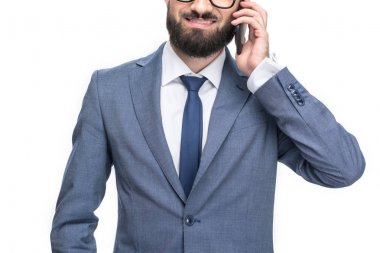 Cropped view of smiling businessman in grey suit using smartphone, isolated on white stock vector