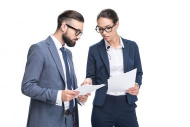businesspeople in suits looking at papers