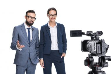 newscasters looking at camera
