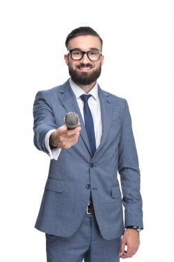 Handsome smiling male television reporter taking interview with microphone, isolated on white stock vector