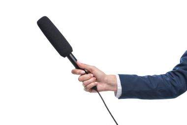 holding microphone for interview