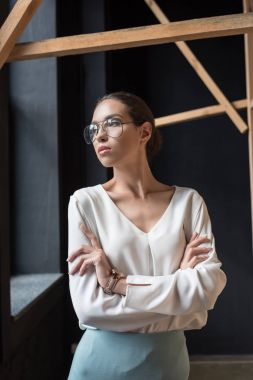 Stylish businesswoman with crossed arms