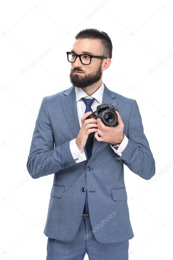 businessman taking photo on camera