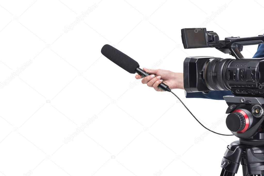 video camera and hand with microphone