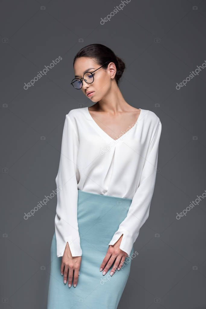Businesswoman posing in eyeglasses