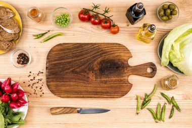 wooden cutting board and vegetables