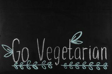 go vegetarian lettering on blackboard