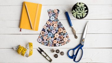 dress made of buttons and tailoring items