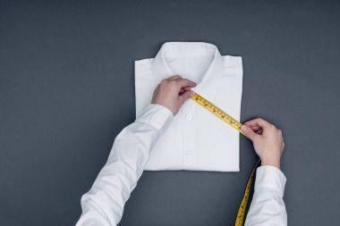 tailor measuring shirt