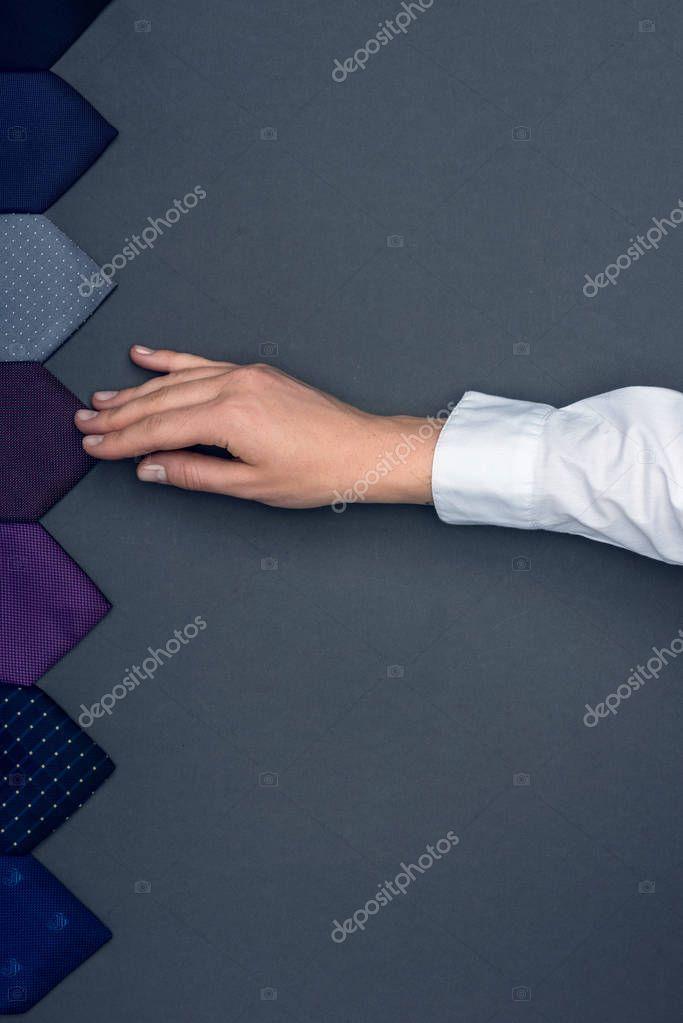 tailor touching neckties