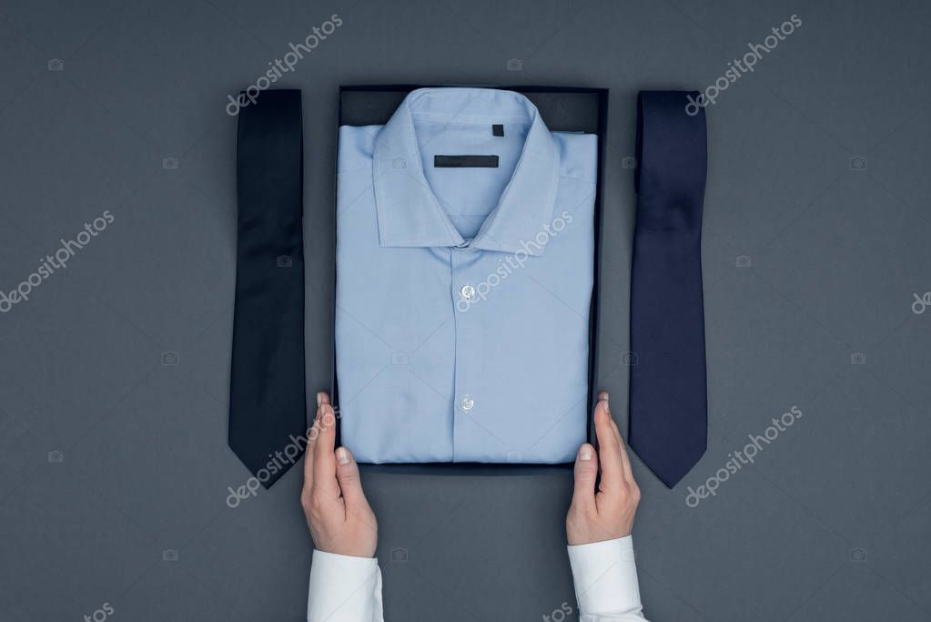 tailor with shirt in box and neckties