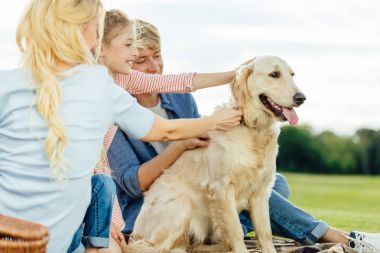 happy family with dog in park
