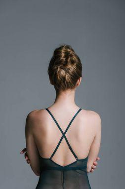 woman with slim body in bodysuit