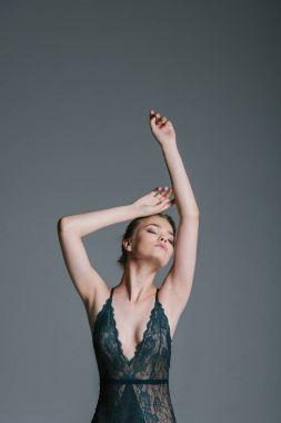 sensual woman in lace bodysuit