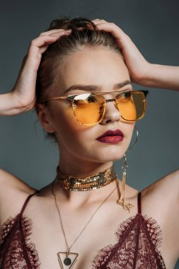 seductive model in orange sunglasses