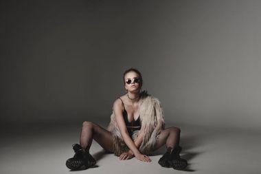 fashionable girl in fur coat