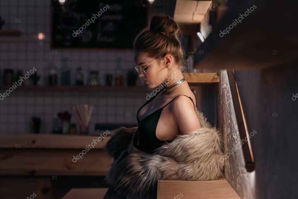 fashionable young woman in fur coat