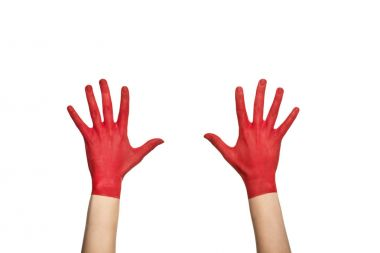 hands in red paint