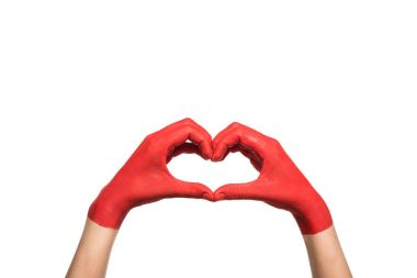 Cropped view of hands in red paint showing heart sign, isolated on white stock vector