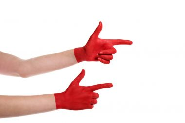 pointing hands in red paint