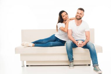 Young attractive couple on couch