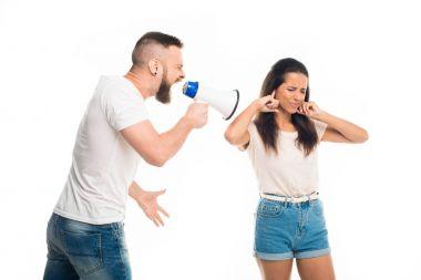 man screaming on woman