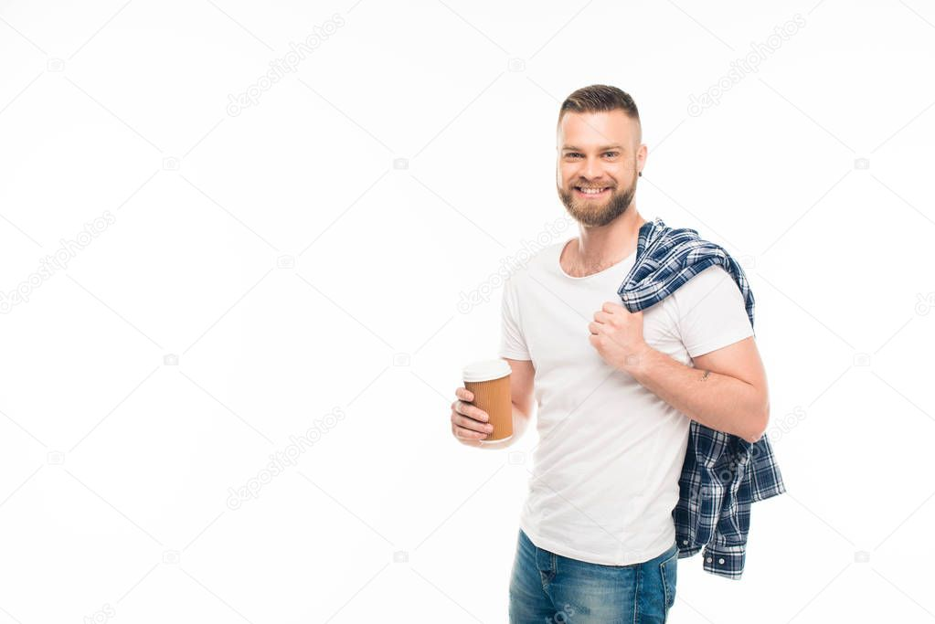 Bearded man with disposable cup of coffee