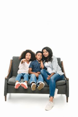 shocked mother with kids on sofa