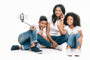 mother with kids taking selfie