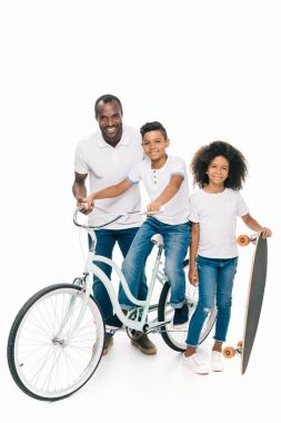 African american family with bicycle and skateboard